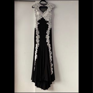 Form-fitted black dress with white lace